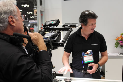 Pictured: Richard Schleuning from Carl Zeiss, (right).; PhotoPlus Expo, Manhattan, New York; photo by Jody Michelle Solis.