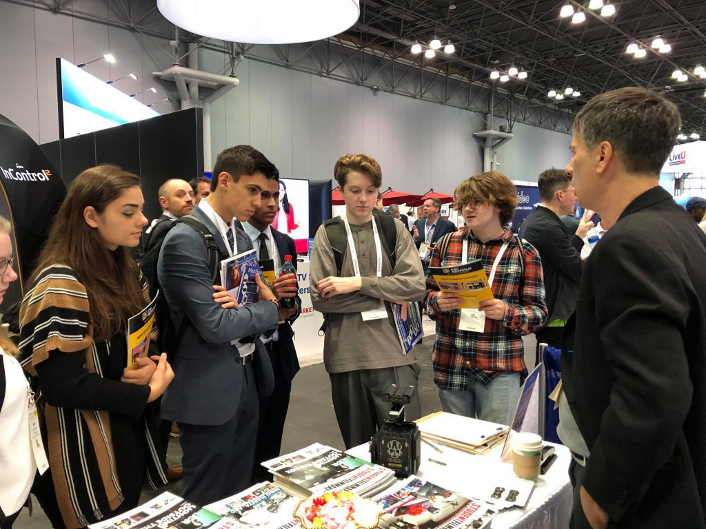 Students networking at the StudentFilmmakers Magazine Exhibit at NAB Show New York