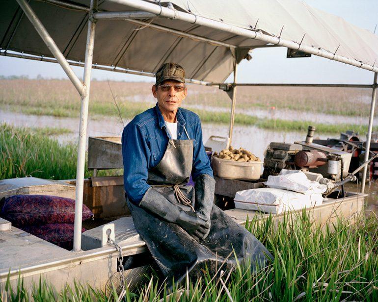 Photo by Michelle Bogre. Leo Smith, crawfish farmer, Gueydan, LA.