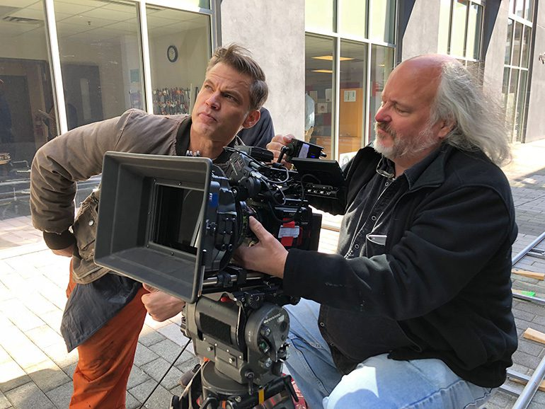"Brad Rushing, csc with actor Casper Van Dien on the set of ""Salvage Marines."""