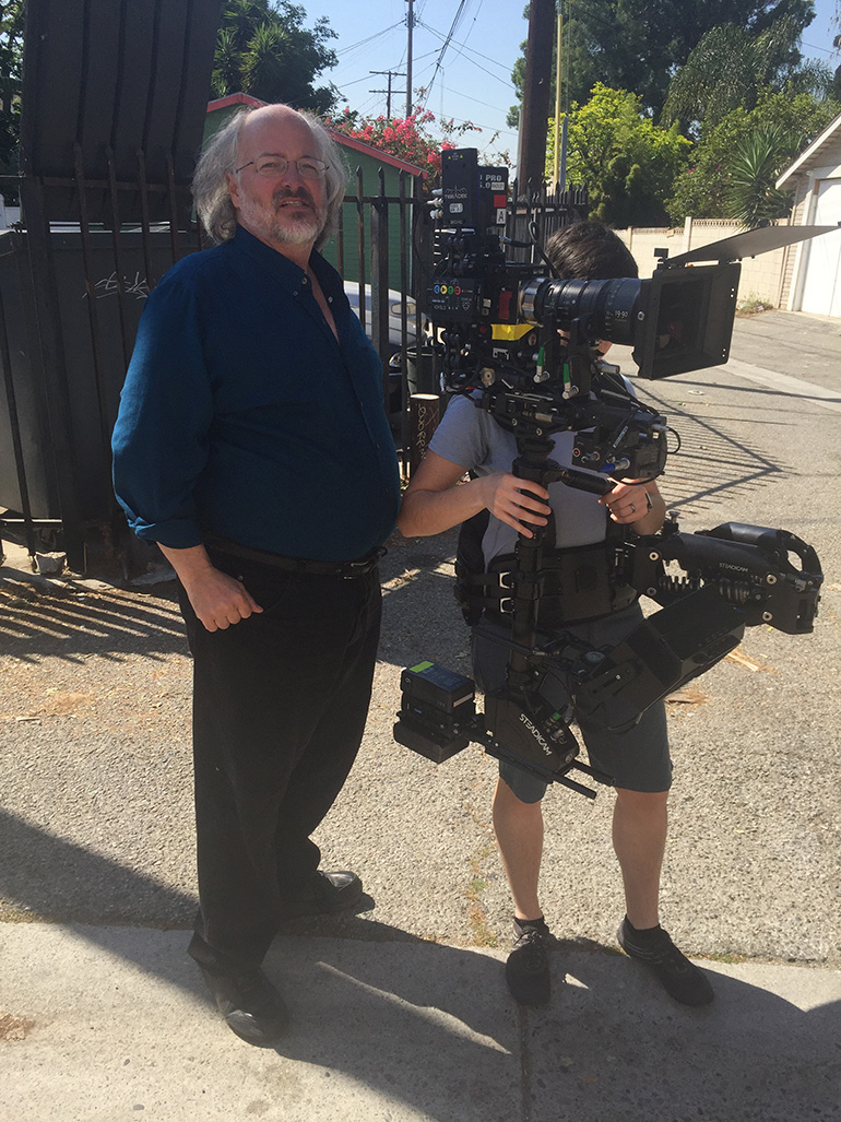 "Brad Rushing, csc and Steadicam Operator Timber Hoy on the set of ""[in]visible."""