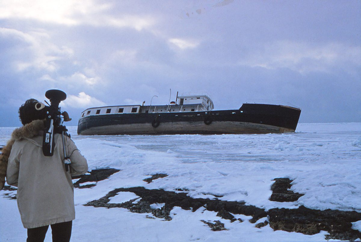 Walking across loose ice to the shipwreck.